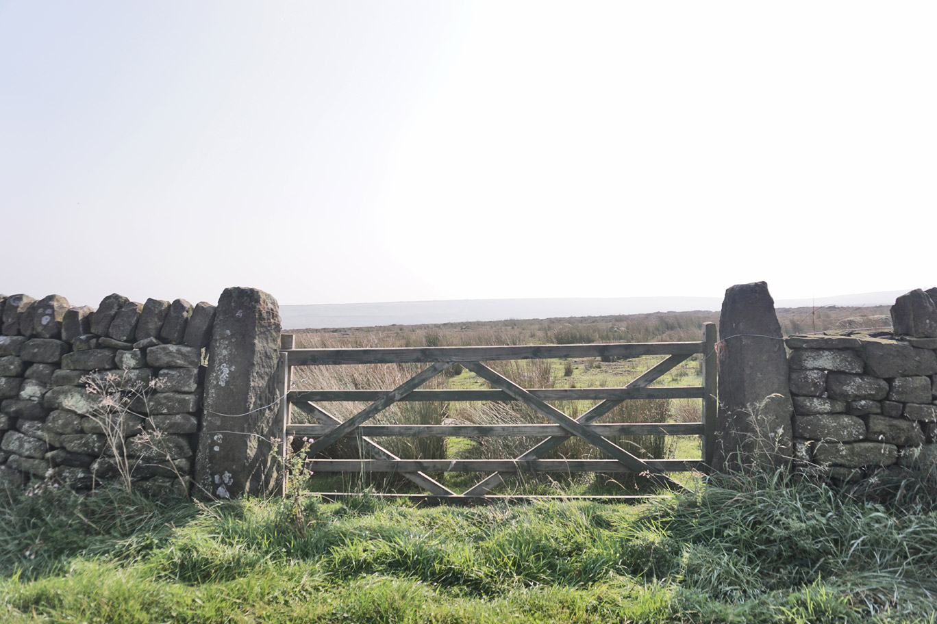 Countryside gate with the sun shining through