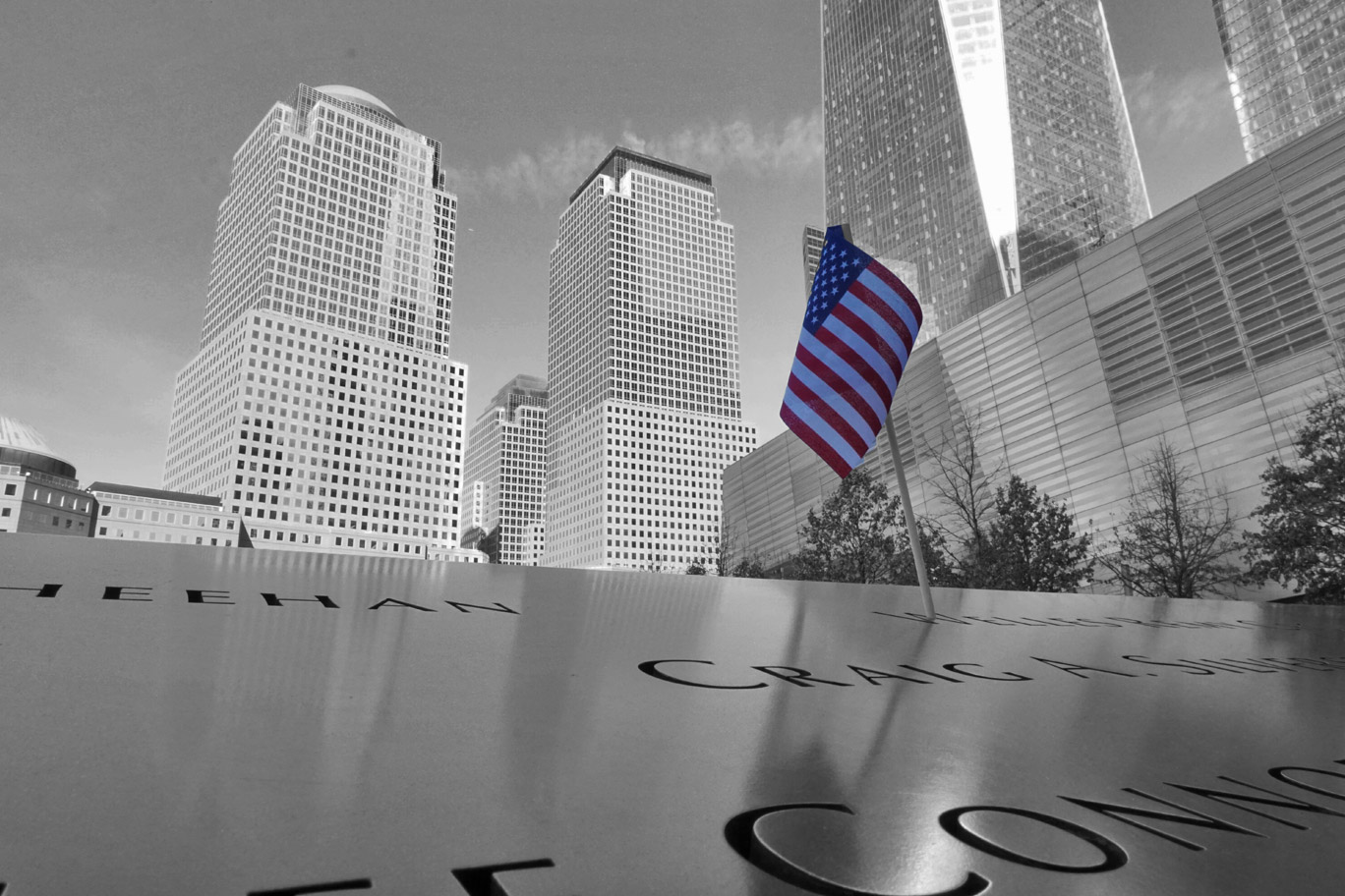 World Trade memorial site with American flag