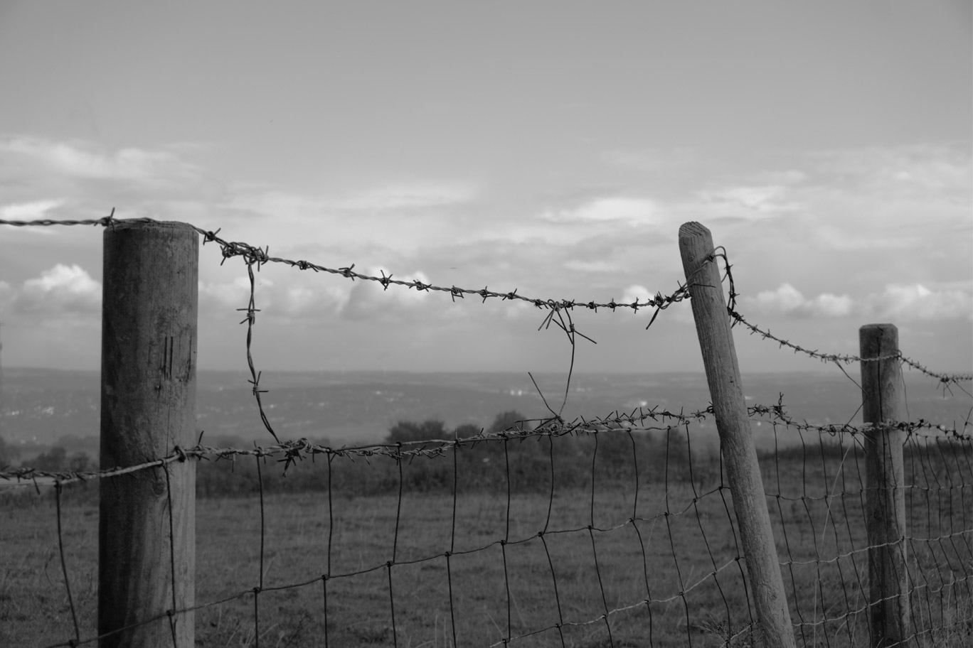 Barbed wire fence looking over Sheffield